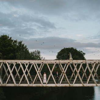 West Cork Wedding Photographer Couple on the old railway bridge in Skibbereen