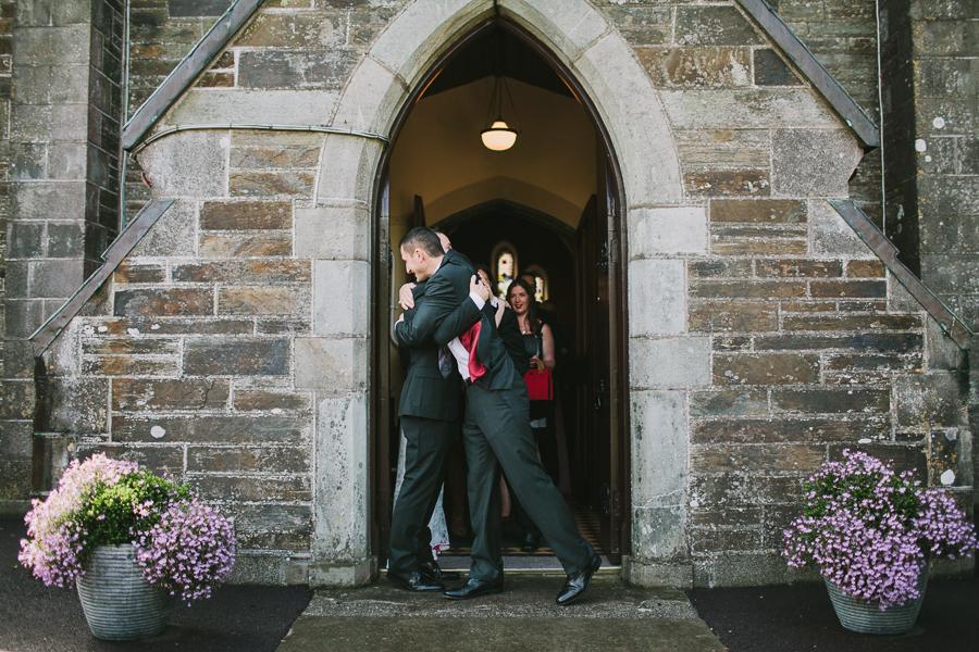 Brotherly hugs outside Abbeystrewry church wedding